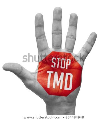 Stop TMD Sign Painted, Open Hand Raised. Stock photo © tashatuvango