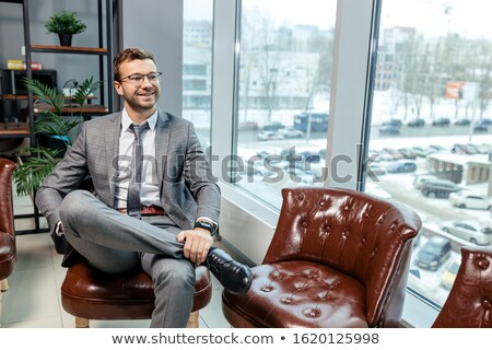 beard man sitting and smiling at the camera stock photo © feedough