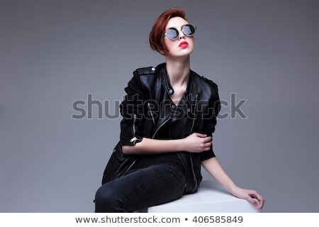 Portré fiatal nő bőrdzseki mosolyog izolált szürke Stock fotó © courtyardpix