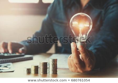 Creative ampoule mains mettre électricité main Photo stock © vgarts