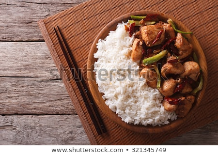 Bowl of rice with vegetables on bamboo mat Stock photo © BSANI