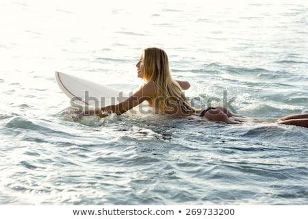 Mosolyog szörfös lány tart szörfdeszka tengerpart Stock fotó © wavebreak_media