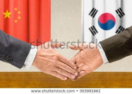 China Coréia do Sul apertar a mão mãos mão reunião Foto stock © Zerbor
