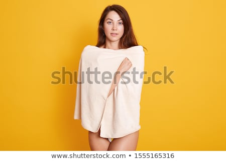 Woman standing in towel and looking back at camera Stock photo © deandrobot