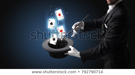Illusionist Shows Tricks with Playing Card Stock photo © Discovod