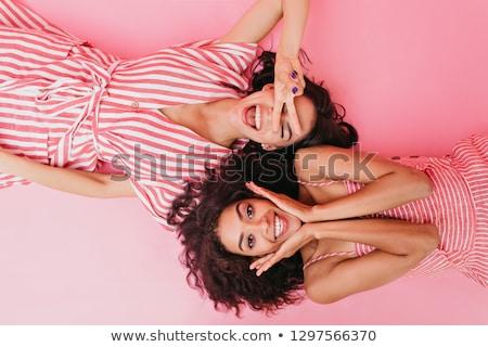 Dois atraente meninas mentir diversão belo Foto stock © Aikon