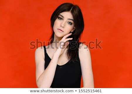 portrait of beautiful alluring young woman in black swimsuit stock photo © deandrobot