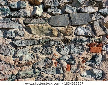 Foto stock: Old Grunge Wall Of An Old House With Remainings Of Color