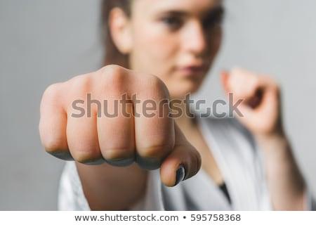 Jonge vrouw oefenen zelfverdediging vechten houding witte Stockfoto © artfotodima