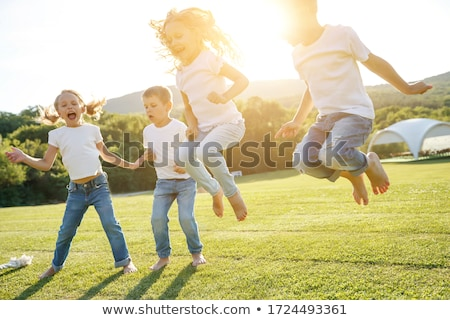 Children playing tug of war in the playground Stock photo © bluering