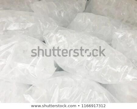 Full plastic bag of crushed ice isolated on white background wit Stock photo © tab62