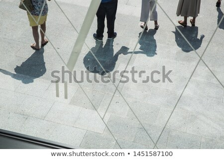 People casting shadows on the pavement Stock photo © stevanovicigor