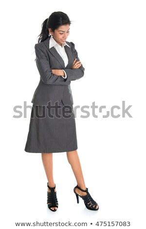 Indian business woman looking downward Stock photo © szefei