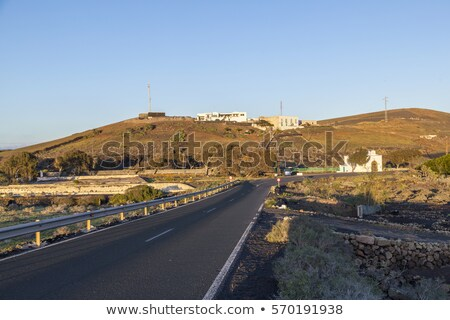 road in hilly area with farm houses in Lanzarote   Stock photo © meinzahn