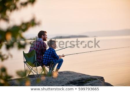 Naplemente csoport halász móló égbolt férfi Stock fotó © joyr