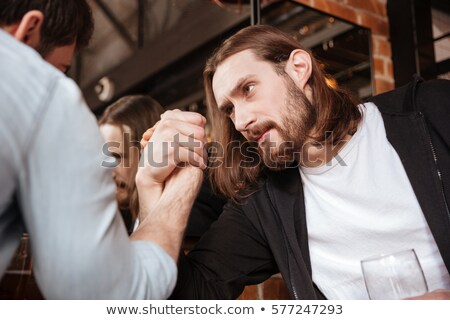 Close up portrait of Drunk friends playing in arm wrestling Stock photo © deandrobot