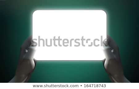 hands and illuminated generic tablet stock photo © albund