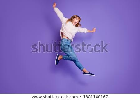 Mutlu neşeli kadın kaldırdı ellerini Stok fotoğraf © deandrobot