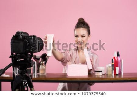 Piękna blogger makijaż pracy twarz lustra Zdjęcia stock © racoolstudio