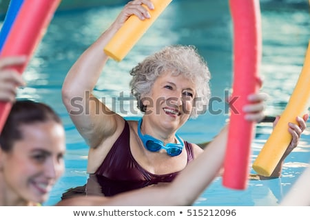 Smiling fit woman doing aqua aerobics Stock photo © wavebreak_media