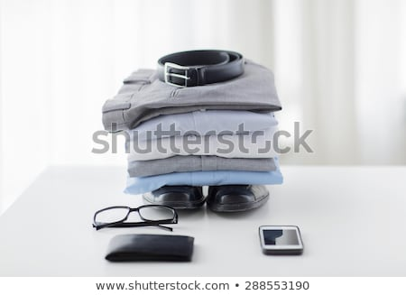clothes, gadgets and business stuff on table Stock photo © dolgachov