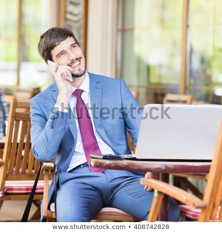 Man talking on phone in french cafe Stock photo © IS2