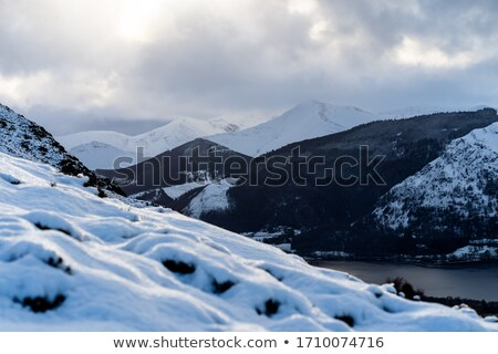 Climber looking over snow covered peak Stock photo © IS2