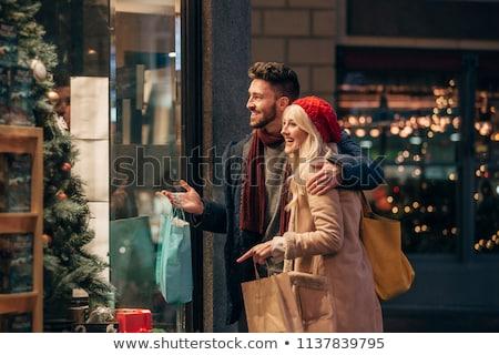 Pár vásárlás magasra tart bevásárlótáskák szeretet férfi Stock fotó © IS2
