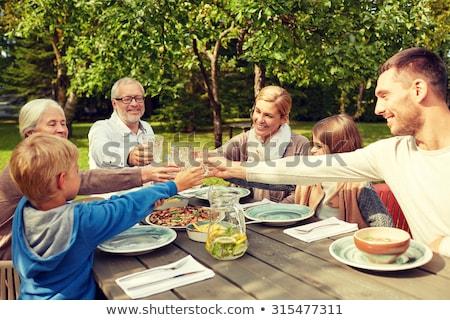 Nagyapa unokák eszik lány gyermek pár Stock fotó © IS2