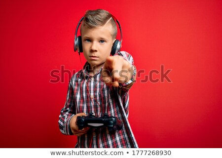 A boy pointing a games console to camera Stock photo © IS2