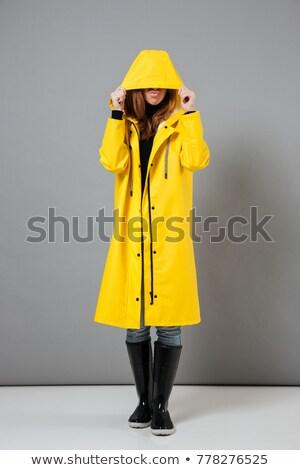 Portret jong meisje regenjas poseren Stockfoto © deandrobot
