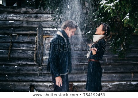 Man and woman laughing in window of hut Stock photo © IS2