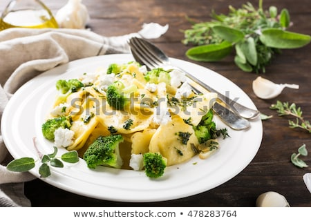 Ravioli with goat cheese, broccoli and herbs Stock photo © Melnyk