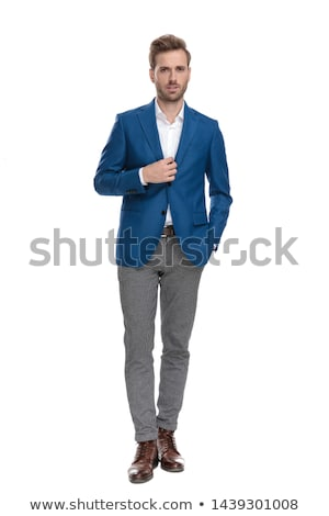 smiling young casual man moving forward with hand in pocket Stock photo © feedough