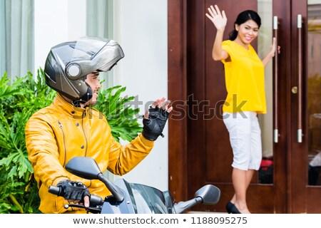 Férfi motoros közmondás viszlát barátnő áll Stock fotó © Kzenon