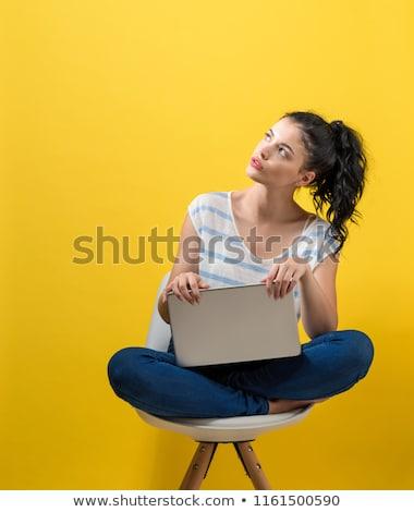 Lány ül fehér szék citromsárga portré Stock fotó © Traimak