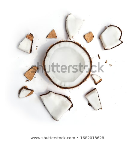A beautiful composition of organic halves and a whole coconut on Stock photo © artjazz