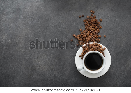black coffee cup with saucer and fresh coffee beans on stone kitchen table background space for tex stock photo © denismart