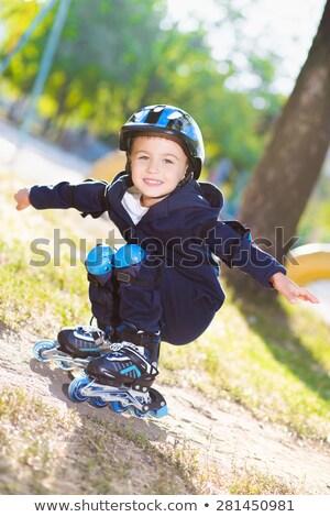 Cute boy rollerblading near the playground Stock photo © acidgrey