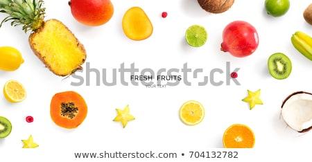Trópusi egzotikus gyümölcsök érett ananász mangó Stock fotó © artjazz
