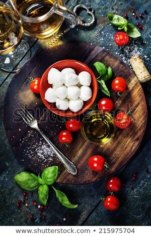 caprese salad with tomatoes basil and mozzarella with wine stock photo © karandaev