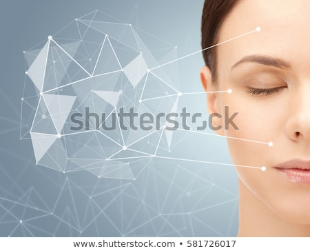 face of beautiful woman with low poly projection Stock photo © dolgachov