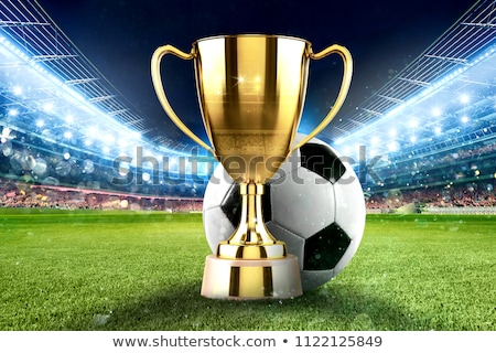 Golden winner s cup in the middle of a soccer stadium with audience Stock photo © alphaspirit
