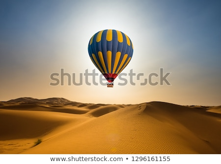 travel by hot air balloon at desert stock photo © bluering