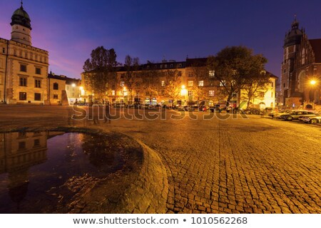 Corpus Christi Basilica and old city hall on Wolnica Square in K Stock photo © benkrut