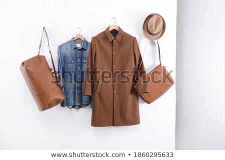 Man in brown overcoat and hat Stock photo © colematt