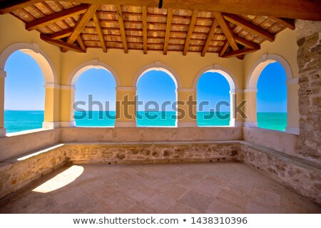 traditional istrian town lodge and turquoise sea in novigrad ist stock photo © xbrchx