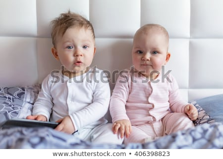 twin baby boy child play fun in bed stock photo © lopolo