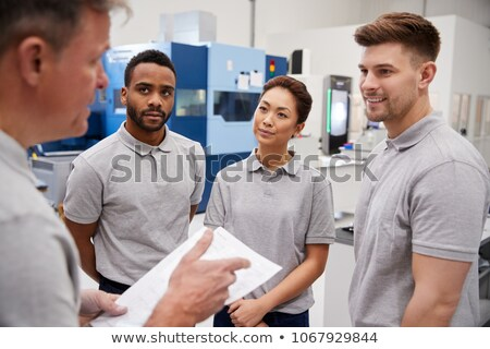 workers on the factory floor in discussion stock photo © kzenon