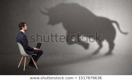 Businessman staying and offering stuffs to a huge businessman shadow Stock photo © ra2studio